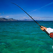 Woman with fishing rod in Loreto. Baja California Sur. Mexico.