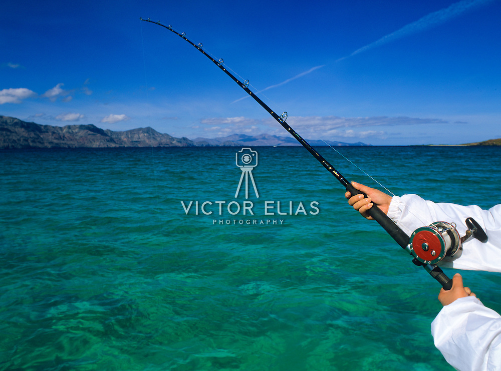 Woman with fishing rod in Loreto. Baja California Sur. Mexico.
