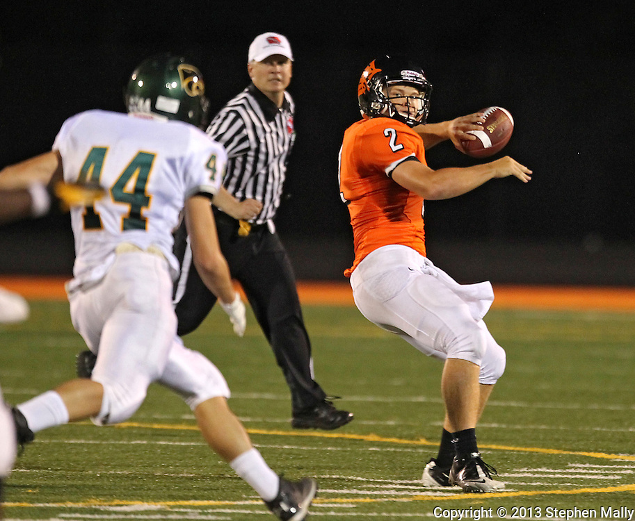 Prairie's Trey Beckman (2) drops back to throw as Kennedy's Jordan Lunsford (44) closes in during their game at John Wall Memorial Stadium at Prairie High School in Cedar Rapids on Friday, September 6, 2013.