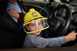 © Licensed to London News Pictures. 09/09/2017. London, UK. Daniel, aged 3, at the wheel of a Mini Countryman Initial Response vehicle, used during the 2012 London Olympics.  Visitors attend London Fire Brigade's annual Fire Engine Festival in Lambeth to see the earliest motorised fire engines still working, London Fire Brigade's brand new pump as well as being able to try on firefighter uniforms. Photo credit : Stephen Chung/LNP