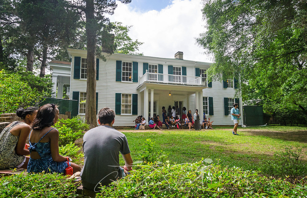 Teenagers talk outside Rowan Oak, the home of author William Faulkner, May 30, 2015, in Oxford, Mississippi. Approximately 120 high school students toured the home as part of the University of Mississippi's Summer College for High School Students. (Photo by Carmen K. Sisson/Cloudybright)