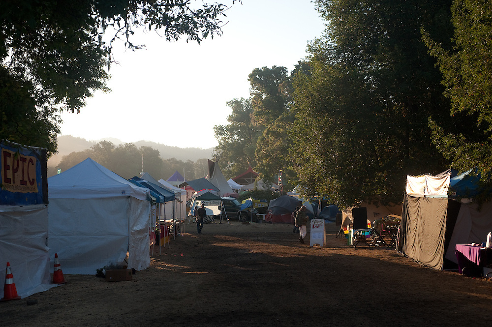 Sunrise and haze over the tents.