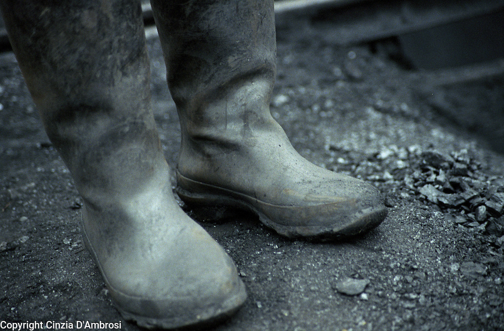 Rubber boots on coal mine. China is one of the largest producer of coal in the world and it has also one of the worse recorded mining conditions. And to make matter worse, illegal coal mining has increased over the years making coal miners lives at even more risks. Lan Ba Coal Mine on the Laoying mountain is an example of one of the illegal coal mines. ..