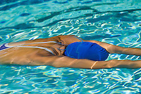 Woman in Swim Cap Swimming Underwater