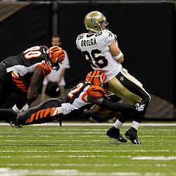 2009 August 14: Cincinnati Bengals linebacker Abdul Hodge (52) hits New Orleans Saints tight end Buck Ortega (86) from behind during a preseason opener between the Cincinnati Bengals and the New Orleans Saints at the Louisiana Superdome in New Orleans, Louisiana.