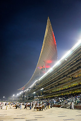 Horseracing meeting at Al Meydan racecourse at night in Dubai United Arab Emirates
