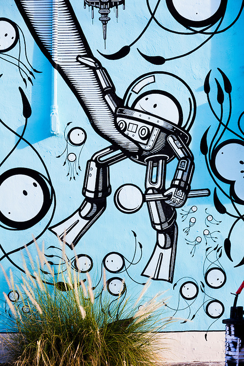 Detail of a whimsical mural painted by the so-called London Police in Miami's Wynwood arts district depicting science-fiction-like deep sea diving devices for little, round-faced creatures