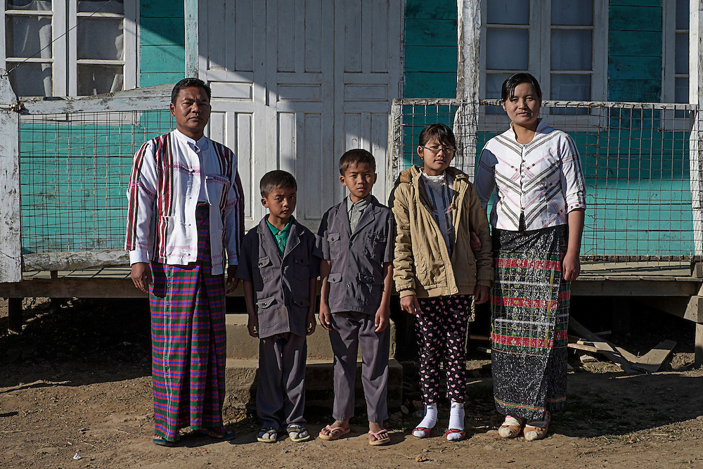 The family of the Prophet in Tedim village.<br /> They believe in a supreme God called Pasian and a prophet called Pa Kam Suan Mang who is alive and lead the cult from a Siangswan village in Tedim township.