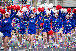 © Licensed to London News Pictures. 01/01/2018. London, UK. Cheerleaders celebrate amid confetti at the New Year's Day Parade in Central London. Photo credit: Rob Pinney/LNP