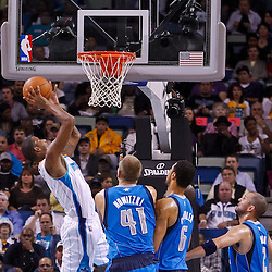 November 17, 2010; New Orleans, LA, USA; New Orleans Hornets small forward Trevor Ariza (1) shoots over Dallas Mavericks power forward Dirk Nowitzki (41) of Germany and center Tyson Chandler (6) during the first half at the New Orleans Arena. Mandatory Credit: Derick E. Hingle