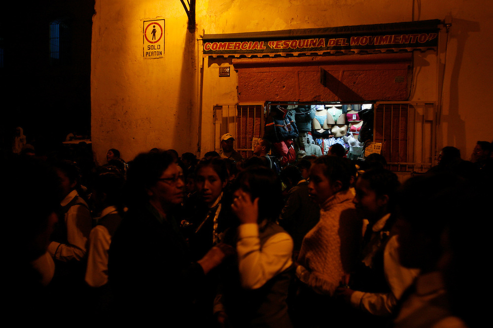 "A young boy watches the procession for Saint Mary in Ayacucho, Peru, ((lat -13.1548°, long -74.2044°, Altitude: 9,202 Feet - http://www.fallingrain.com/world/PE/5/Ayacucho.html), Wednesday night, May 14, 2008. The procession continued from the Plaza de Armas to all the the major cathedrals, of which there are more than 33, one for every year that Christ was alive, in this city known as as ""Sevilla Peruana"" for its religious festivities of Semana Santa (Holly Week) and ""Ciudad de las Iglesias"" (city of the churches)."
