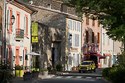 Shops and local businesses on main Le Promenade street, on 21st May 2017, in Lagrasse, Languedoc-Rousillon, south of France. Lagrasse is listed as one of France's most beautiful villages and lies on the famous Route 20 wine route in the Basses-Corbieres region dating to the 13th century.