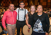 Former EMERGE student and Stanford freshman Felipe Guillen poses for a photograph with his family during the State of the Schools luncheon, February 11, 2015.
