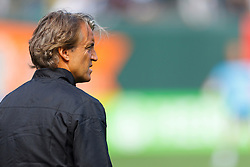 July 16, 2011; San Francisco, CA, USA;  Manchester City head coach Roberto Mancini watches his team warm up before the game against  Club America at AT&T Park. Manchester City defeated Club America 2-0.