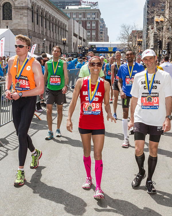 2014 Boston Marathon: finishers with medals in recovery zone