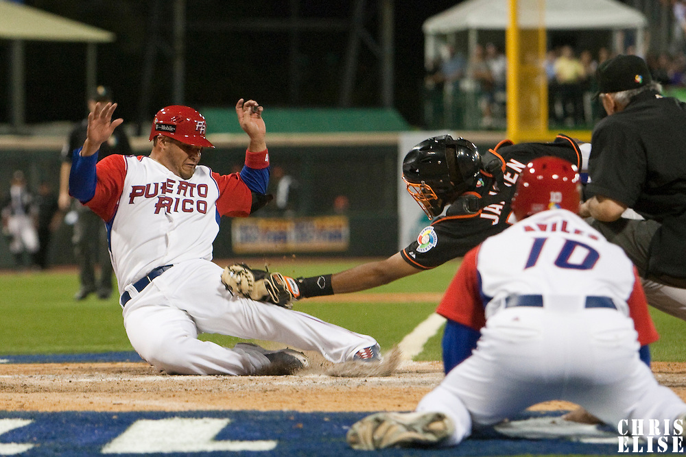9 March 2009: #4 Yadier Molina of Puerto Rico is tagged out at the plate by #50 Kenley Jansen of The Netherlands during the 2009 World Baseball Classic Pool D game 4 at Hiram Bithorn Stadium in San Juan, Puerto Rico. Puerto Rico wins 3-1 over Netherlands
