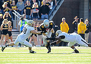 November 10 2012: Iowa Hawkeyes quarterback James Vandenberg (16) is sacked by Purdue Boilermakers defensive end Robert Maci (58) and Purdue Boilermakers defensive tackle Kawann Short (93) during the NCAA football game between the Purdue Boilermakers and the Iowa Hawkeyes at Kinnick Stadium in Iowa City, Iowa on Saturday, November 10, 2012. Purdue defeated Iowa 27-24.