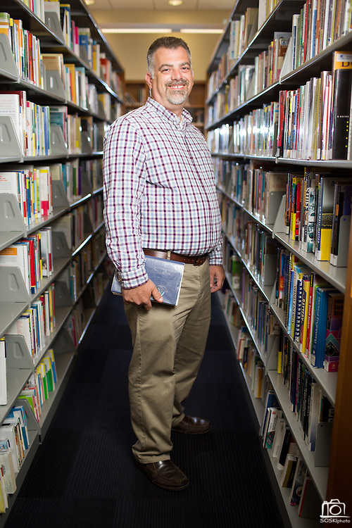 New Librarian Stephen Fitzgerald poses for a portrait in the adult non-fiction section of the Milpitas Library in Milpitas, California, on September 9, 2014. (Stan Olszewski/SOSKIphoto)