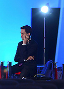 © Licensed to London News Pictures. 03/10/2012. Manchester, UK Ed Miliband, Labour Party leader waits to give a television interview on Day 4 at The Labour Party Conference at Manchester Central today 3rd october 2012. Photo credit : Stephen Simpson/LNP