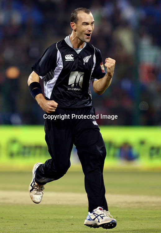 New Zealand bowler Andy Mckay celebrates with Brendon McCullum Indian batsman Virat Kohli wicket during the 4th ODI match India vs New Zealand Played at M Chinnaswamy Stadium, Bangalore, 7 December 2010 - day/night (50-over match)