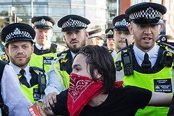 London, UK. 20 September, 2019. Metropolitan Police officers disperse students and climate campaigners blocking Lambeth Bridge during the second Global Climate Strike by force using s14 of the Public Order Act 1986. The Global Climate Strike, called in protest against a lack of urgent action by the UK Government to combat the global climate crisis, grew out of the Fridays for Future movement and is organised in the UK by the UK Student Climate Network.