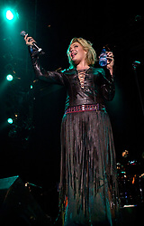 Kim Wilde steps out of the her TV Gardening clothes and Back on Stage to Tour with<br /><br />Steve Starnge (Visage)<br />Claire Grogan (Altered Images)<br />The Belle Stars<br />Dollar<br />Kim Wilde<br />The Human League<br />Play on the Here and Now  Christmas Party Tour at Sheffields Hallam FM Arena Friday 13th December 2002<br /><br />[#Beginning of Shooting Data Section]<br />Nikon D1 <br />2002/12/13 22:33:51.1<br />JPEG (8-bit) Fine<br />Image Size:  2000 x 1312<br />Color<br />Lens: 24mm f/2.8<br />Focal Length: 24mm<br />Exposure Mode: Manual<br />Metering Mode: Spot<br />1/200 sec - f/2.8<br />Exposure Comp.: 0 EV<br />Sensitivity: ISO 800<br />White Balance: Auto<br />AF Mode: AF-S<br />Tone Comp: Normal<br />Flash Sync Mode: Not Attached<br />Color Mode: <br />Hue Adjustment: <br />Sharpening: Normal<br />Noise Reduction: <br />Image Comment: <br />[#End of Shooting Data Section]