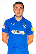 AFC Wimbledon midfielder Anthony Hartigan (8) during the official team photocall for AFC Wimbledon at the Cherry Red Records Stadium, Kingston, England on 8 August 2019.