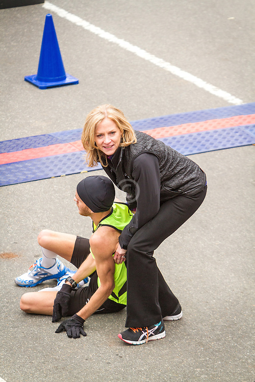 ING New York CIty Marathon: race director Mary Wittenberg helps Jeff Eggleston, USA, from the ground after finishing