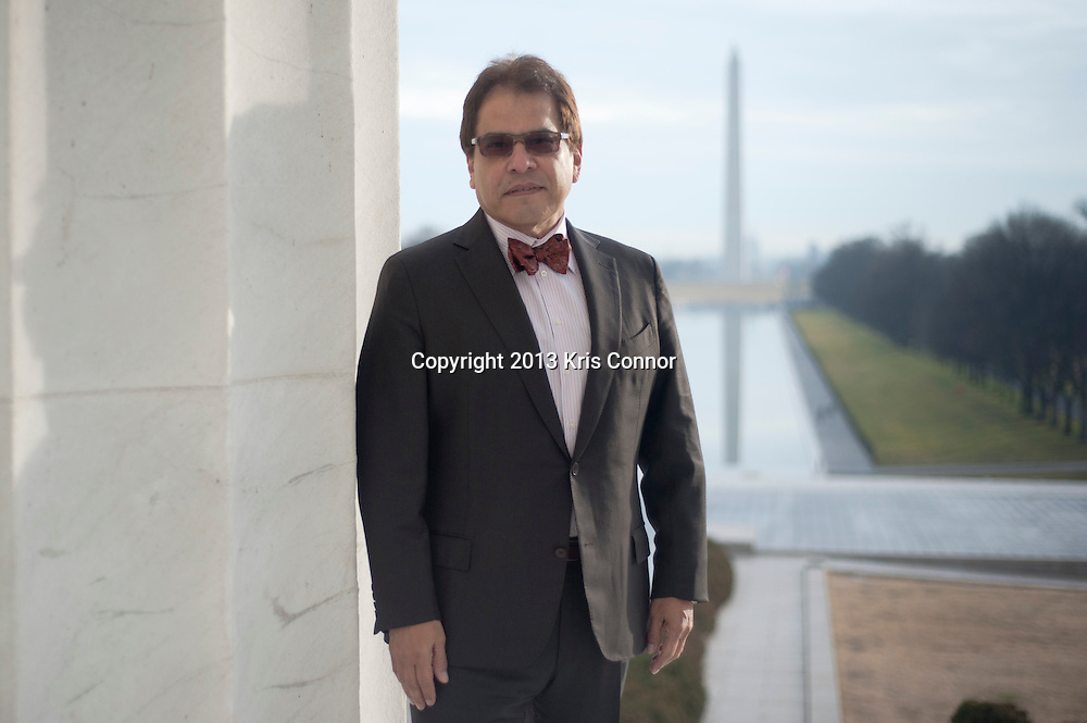 Mario Castillo of The Aegis Group poses for a portrait at the Lincoln Memorial in Washington D.C. on January 11, 2013. Photo by Kris Connor