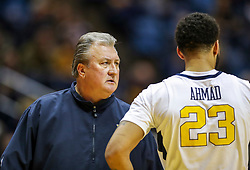 Nov 28, 2018; Morgantown, WV, USA; West Virginia Mountaineers head coach Bob Huggins talks with West Virginia Mountaineers forward Esa Ahmad (23) during the second half against the Rider Broncs at WVU Coliseum. Mandatory Credit: Ben Queen-USA TODAY Sports