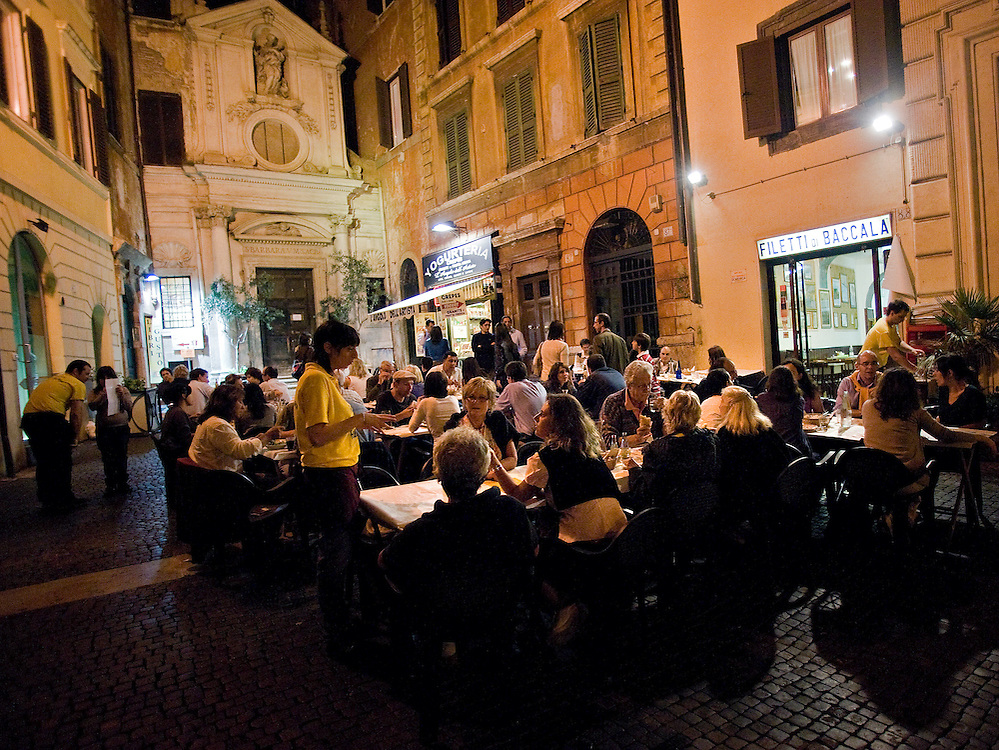Patrons dine outside at Filetti di Baccalà, a restaurant in Rome that serves just that--battered, deep-fried fillets of salt cod--and not much else.