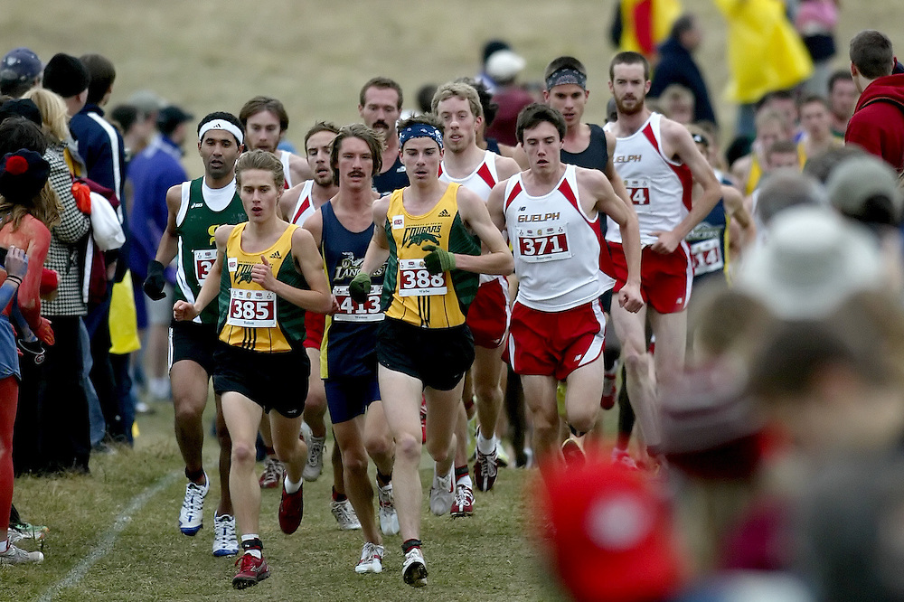 (Kingston, Ontario -- 14 Nov 2009)  WYATT BAITON of the University of Regina and KELLY WIEBE of the University of Regina lead the first lap of the 2009 Canadian Interuniversity Sport CIS Cross Country Championships at Forth Henry Hill in Kingston Ontario. Photograph copyright Sean Burges / Mundo Sport Images, 2009.