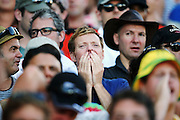 Cricket fans look on during the closing stage of the match. 2015 ICC Cricket World Cup match between New Zealand Back Caps and Australia at Eden Park, Auckland, New Zealand. Saturday 28 February 2015. Photo: Anthony Au-Yeung / www.photosport.co.nz
