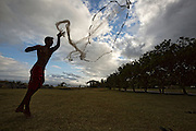 At the Ho'ea Initiative base camp located at the Keawanui Fishpond on Molokai, Kai Kahoaliki Fonseca, 18 practices throw net.