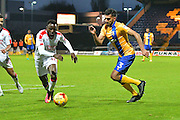 Mansfield Town defender Malvind Benning (3) and Crawley Town midfielder Bobson Bawling (17) battle during the EFL Sky Bet League 2 match between Mansfield Town and Crawley Town at the One Call Stadium, Mansfield, England on 19 November 2016. Photo by Simon Trafford.