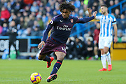 Arsenal forward Alex Iwobi (17) in action during the Premier League match between Huddersfield Town and Arsenal at the John Smiths Stadium, Huddersfield, England on 9 February 2019.