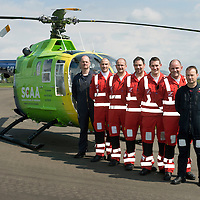 SCAA..Scotland's Charity Air Ambulance paramedics pictured with Helimed 76 at the base in Perth, pictured from left, Pilot Russell Myles, John Pritchard, Andy Walker, Alex Holden, Wayne Auton, Bruce Rumgay and Pilot John Stupart<br /> The helicopter is a Bolkow 105 supplied by Bond Aviation Services.<br /> Picture by Graeme Hart.<br /> Copyright Perthshire Picture Agency<br /> Tel: 01738 623350  Mobile: 07990 594431