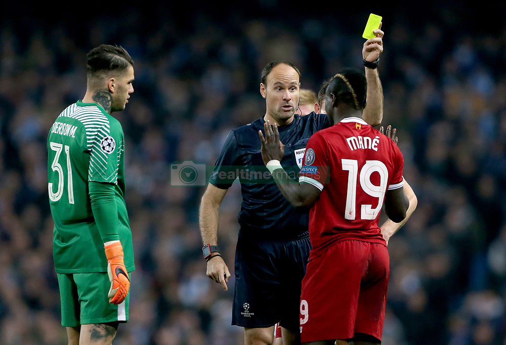 Liverpool's Sadio Mane is booked by match referee Antonio Miguel Mateu Lahoz during the UEFA Champions League, Quarter Final at the Etihad Stadium, Manchester.