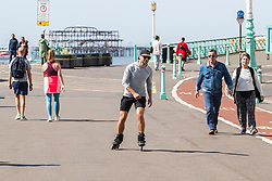 © Licensed to London News Pictures.07/04/2020. Brighton, UK. Members of the public enjoy the warmer weather by taking a walk on the Brighton and Hove promenade. Photo credit: Hugo Michiels/LNP
