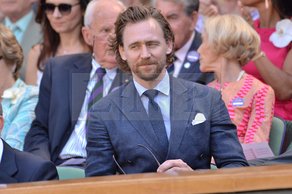 © Licensed to London News Pictures. 15/07/2018. London, UK. Actor Tom Hiddlestone watches center court tennis in the royal box on the second day of the Wimbledon Tennis Championships 2018 held at the All England Lawn Tennis and Croquet Club. Photo credit: Ray Tang/LNP
