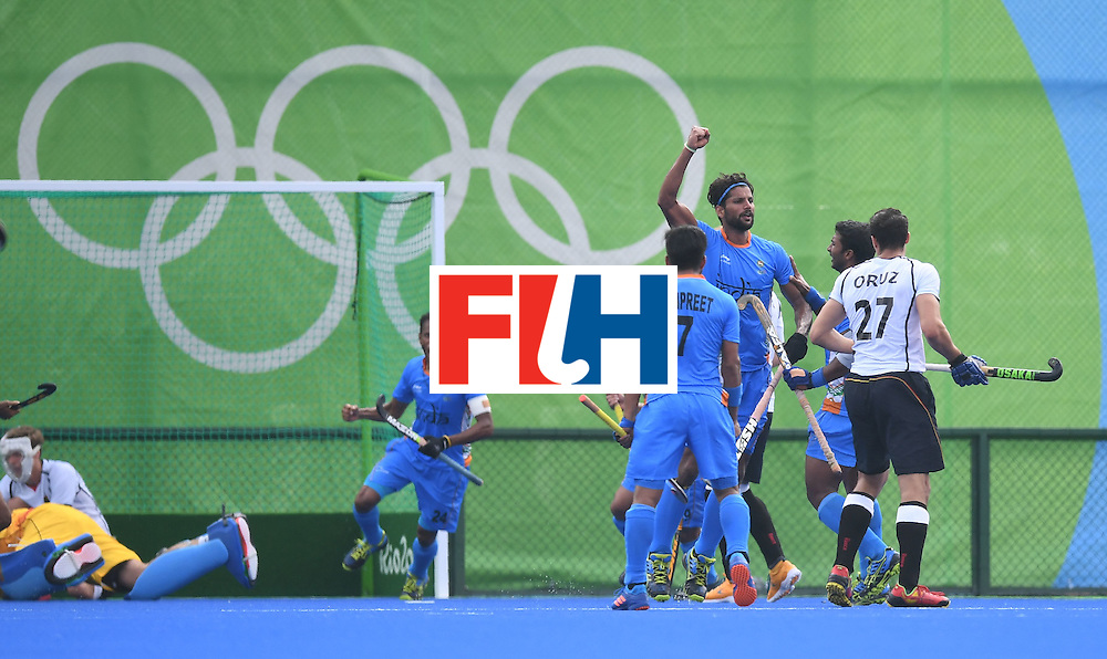 India's Rupinder Pal Singh (3R) celebrates scoring a goal during the men's field hockey Germany vs India match of the Rio 2016 Olympics Games at the Olympic Hockey Centre in Rio de Janeiro on August, 8 2016. / AFP / MANAN VATSYAYANA        (Photo credit should read MANAN VATSYAYANA/AFP/Getty Images)