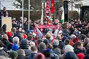 Bayern Munich scarf is held high during the ceremony at Manchesterplatz, Munich, Germany. Picture by Phil Duncan.