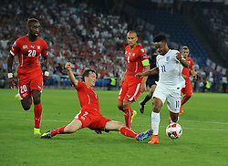 Switzerland's Stephan Lichtsteiner tackles England's Raheem Sterling (Liverpool)  - Photo mandatory by-line: Joe Meredith/JMP - Mobile: 07966 386802 - 08/09/14 - SPORT - FOOTBALL - Switzerland - Basel - St Jacob Park - Switzerland v England - Uefa Euro 2016 Group E Qualifier