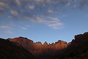 The light of the sunrise just hits the top of the Temple of the Virgin in Zion National Park. Missoula Photographer