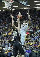 December 28, 2011: Iowa Hawkeyes forward Melsahn Basabe (1) puts up a shot over Purdue Boilermakers forward Travis Carroll (50) during the NCAA basketball game between the Purdue Boilermakers and the Iowa Hawkeyes at Carver-Hawkeye Arena in Iowa City, Iowa on Wednesday, December 28, 2011. Purdue defeated Iowa 79-76.