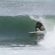 Surfing Monahan's Dock. Swell 12' at 11 secs. Chris Causey recently back from PR getting some tube time.
