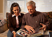 Jacob Helland, right, and his wife, Janet, look through a family photo album featuring photos of his father, Fritz Helland, in their home in Sandy, Thursday, Nov. 1, 2012.