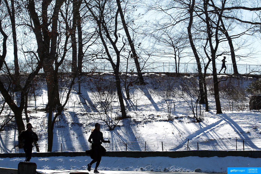 Joggers in Central Park after New York City was hit with over 7 inches of snow during its first winter storm of the year. Central Park, Manhattan, New York, USA. 4th January 2014 Photo Tim Clayton