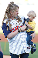 MAY 14, 2010: American Idol Crystal Bowersox with her son Tony before the Toledo Mudhens MiLB baseball game during her hometown celebration in Toledo, Ohio.