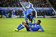 Leicester City midfielder Demarai Gray (7) tends to an injured Leicester City forward Kelechi Iheanacho (8) during the quarter final of the EFL Cup match between Leicester City and Manchester City at the King Power Stadium, Leicester, England on 18 December 2018.